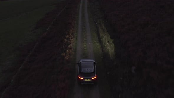 Thumbnail for Aerial Tracking Shot of an SUV Passing Thru a Bumpy Dirt Road