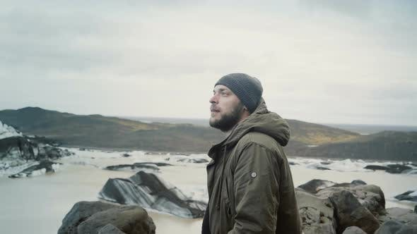 Thumbnail for Young Traveling Man Standing on the Top of the Mountain and Looking on Glaciers in Vatnajokull Ice
