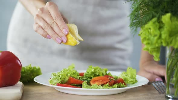 Thumbnail for Housewife Sprinkling Vegetable Salad with Lemon Juice Rich in Vitamins Food