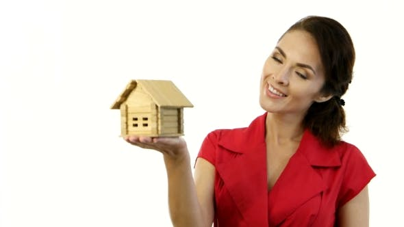 Thumbnail for Happy Woman Holding a Little House In Her Hands
