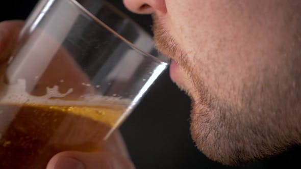 Thumbnail for Man Enjoys His Cold Beer In  Over Black Background