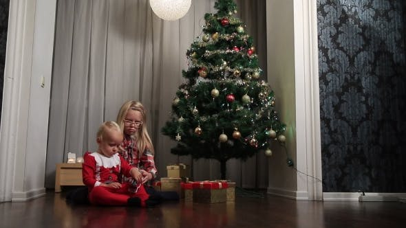 Thumbnail for Little Boy And Girl Opening Presents On Christmas
