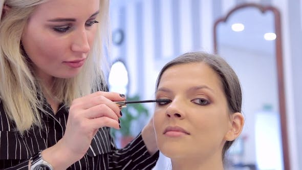 Thumbnail for Make-up Artist Applying The Mascara To Model's Eyes