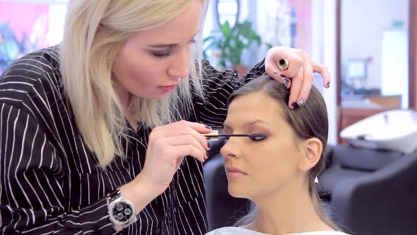 Thumbnail for Professional Make-up Artist Applying Mascara To Model
