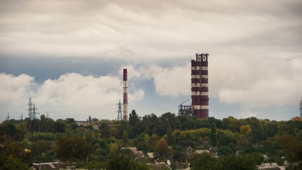 Thumbnail for Clouds Moving Over The Pipe Plant And Buildings.