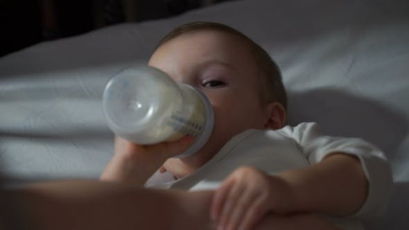 Thumbnail for Baby Eating Baby Food From a Bottle