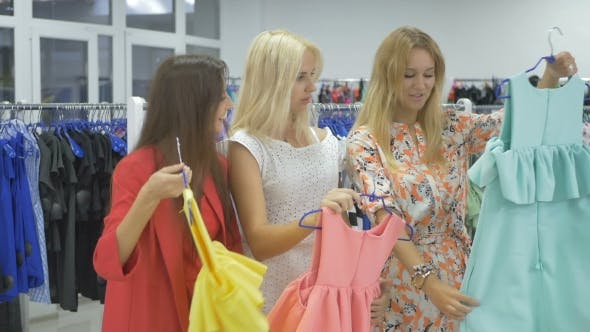 Thumbnail for Three Beautiful Girls Shopping In The Showroom
