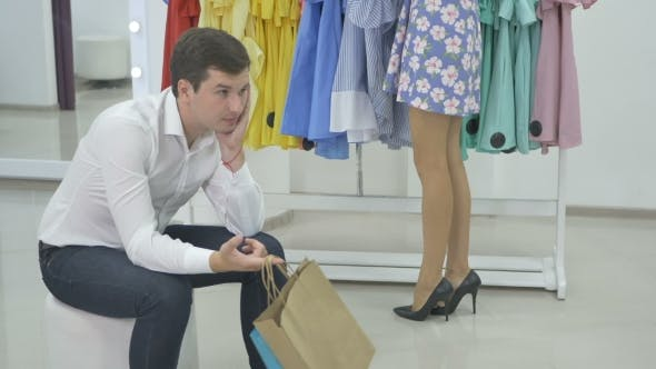 The Guy Wait His Girlfriend During The Shopping