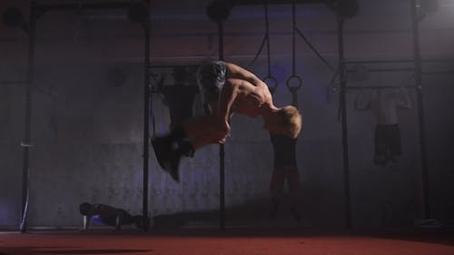 Crossfit Athlete Doing Push-ups And Somersaults.