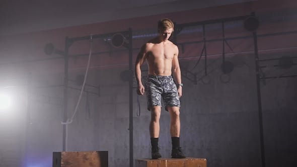 Thumbnail for Shirtless Healthy Athlete Doing Box Jumps At The Gym.