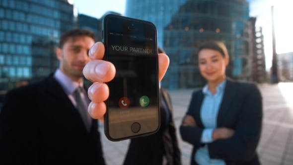 Thumbnail for Businesspeople Give Phone. Your Partner Calling.