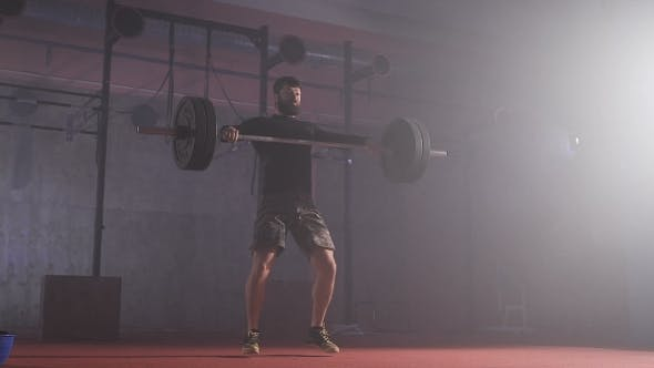 Thumbnail for Strong Man Doing Barbell Snatch Exercise At The Gym In .