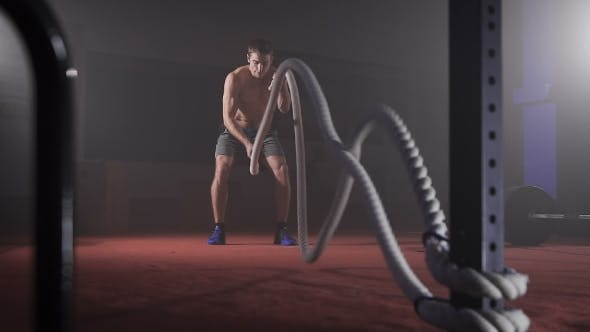 Thumbnail for Cute Muscular Man Doing Crossfit Rope Double Wave Exercise At The Gym.