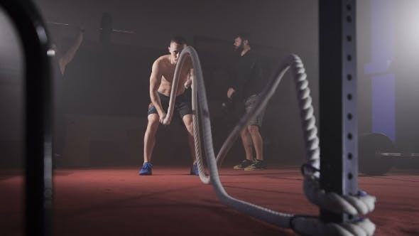 Thumbnail for Sportsman Doing Heavy Rope Training At The Gym.