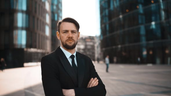 Thumbnail for Portrait Of Successful Confident Adult Entrepreneur Outdoors Looking Into The Camera.