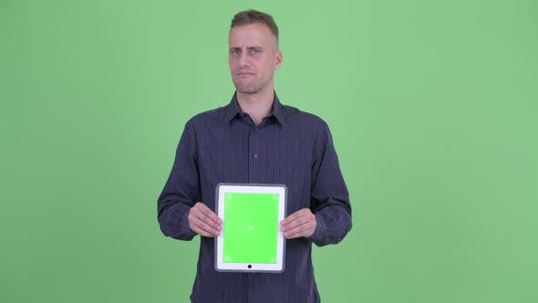 Thumbnail for Stressed Businessman Showing Digital Tablet