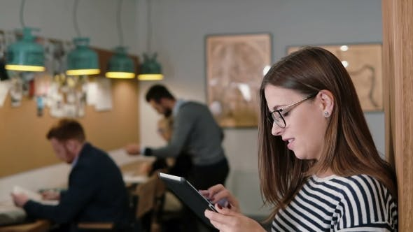 Thumbnail for Beautiful Brunette Business Woman Uses Tablet In Modern Startup Office Team In Workplace