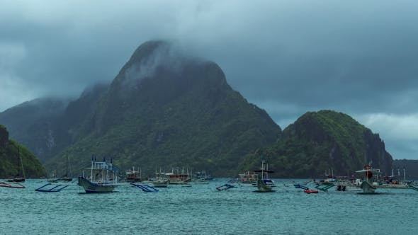 Thumbnail for Fishing Boats In Cloudy Weather In The Bay Of El Nido.   - August 2016, El Nido Palawan, Philippines