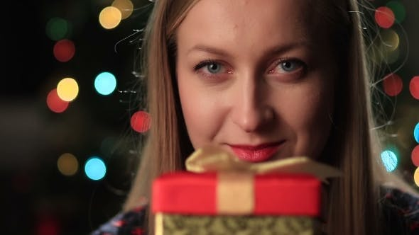 Thumbnail for Happy Young Woman Holding Christmas Present Box