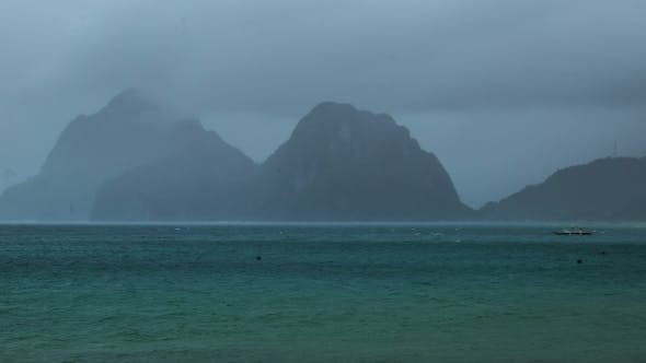 Cover Image for Rain Storm Is Approaching On The Mountain Island In El Nido. Palawan Island, Philippines