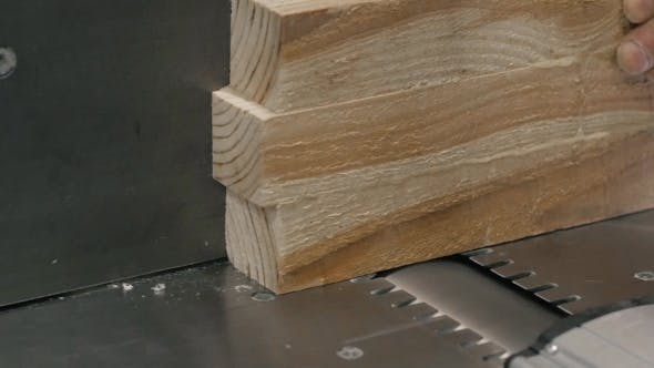 Thumbnail for Man Using a Table Saw To Cut Wood, Grinding On Modern Furniture Factory
