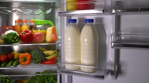 Bottles Of Milk In The Fridge