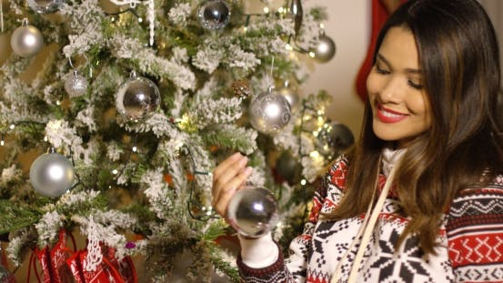 Thumbnail for Pretty Woman Decorating An Xmas Tree With Baubles