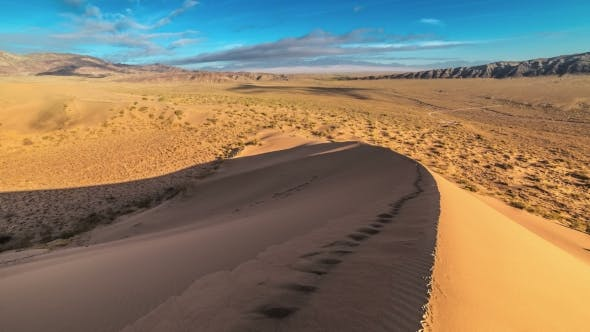 Cover Image for Human Footprints On The Crest Of a Sand Dune In The National Park Altyn Emel.   - September 2016