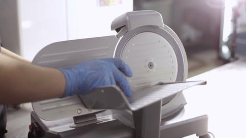 Slice Machine Cuts Ham In Commercial Kitchen