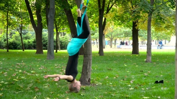 Thumbnail for Young Girl Doing Yoga Exercises On The Air