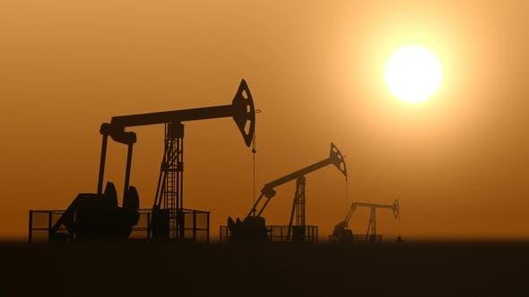 Thumbnail for Oil Pump Jacks in the Desert Against Sunset Extracting Crude Oil