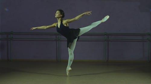 The Dancer Performs An Arabesque