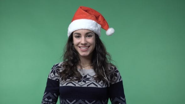 Thumbnail for Brunette Woman In A Red Santa's Cap Smiling