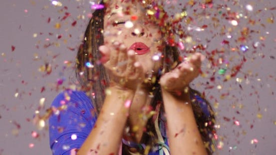 Thumbnail for Cute Young Woman Blowing Confetti