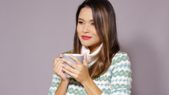 Thumbnail for Attractive Woman Enjoying a Hot Beverage