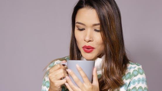 Thumbnail for Gorgeous Young Woman Enjoying Hot Coffee