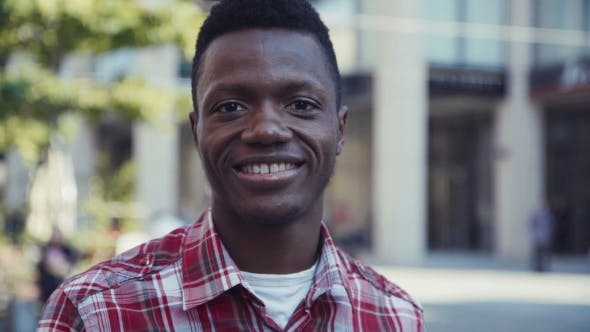 Thumbnail for Afro-American Man Smiles And Looks Right At Camera