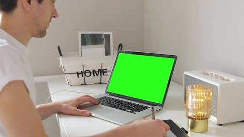 raphic Artist Designer working with stylus pen on with Screen Laptop. Hipster millennial