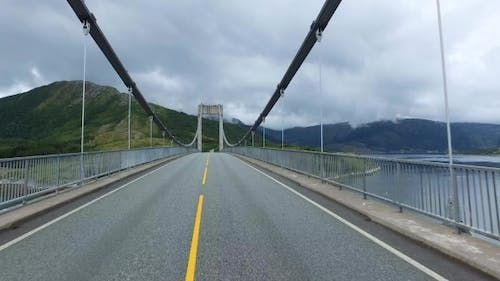 Vehicle Point-of-view Driving Over The Bridge.