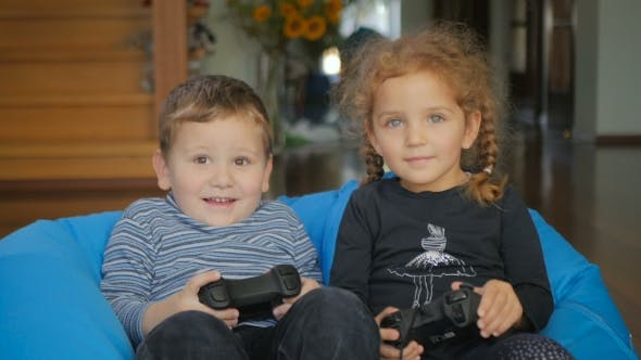 Thumbnail for Cute Boy And Girl Playing a Videogame