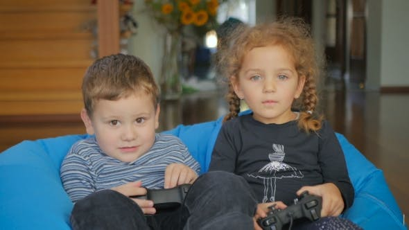 Thumbnail for Cute Children Playing a Game On The Console