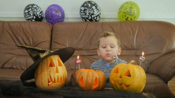 Thumbnail for Boyblows Candles On Scary Pumpkins On Halloween