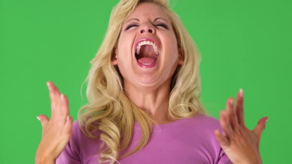 Portrait of blond woman laughing with excitement
