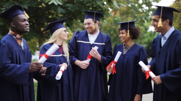 Thumbnail for Happy Students In Mortar Boards With Diplomas 1