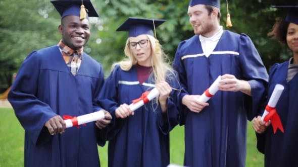 Thumbnail for Happy Students In Mortar Boards With Diplomas 13