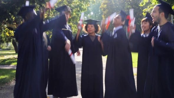 Thumbnail for Happy Students In Mortar Boards With Diplomas 20