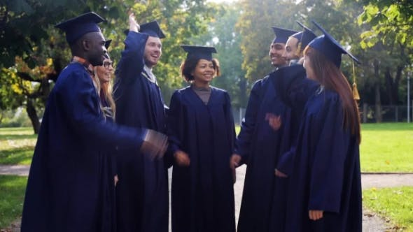 Thumbnail for Happy Students In Mortar Boards Making High Five 31