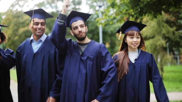 Thumbnail for Happy Students In Mortar Boards With Diplomas 40