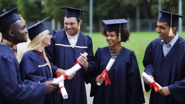 Thumbnail for Happy Students In Mortar Boards With Diplomas 50