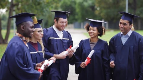 Happy Students In Mortar Boards With Diplomas 56